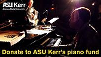 Charles Lewis plays piano in near-silhouette with full band under ASU Kerr's stage lights